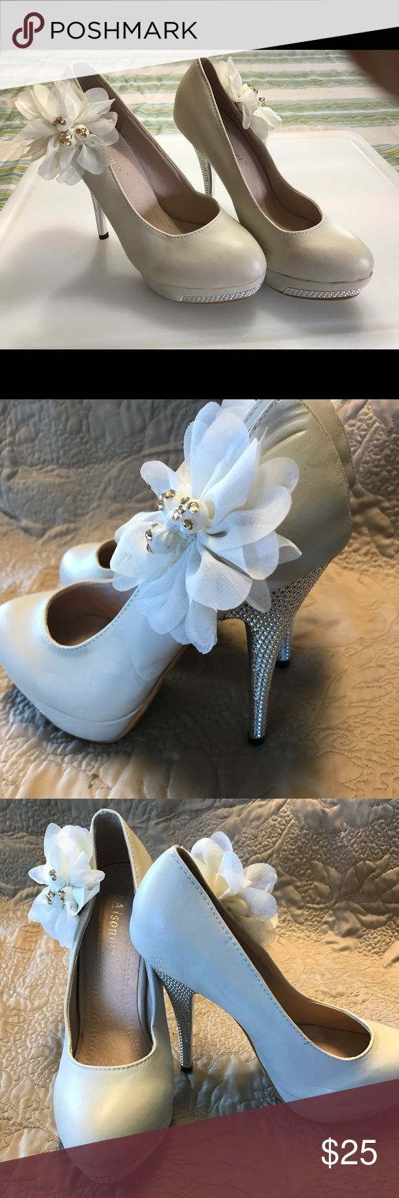 Crystal fancy high heels Cream high heels with crystals on the heel and platform. Silk see thru flower with crystals on the side. Beautiful shoes brand new Shoes Heels