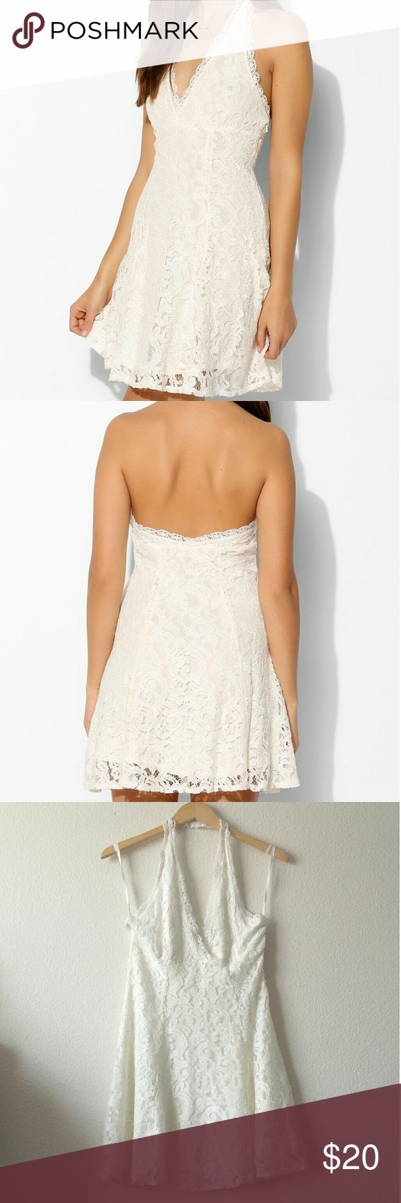 UO Kimchi Blue ivory lace halter dress (NWOT) Ivory lace halter mini dress from Urban Outfitters with a hidden side zipper. Size medium. New without tags. Length approx. 38, bust 17, waist approx. 14.  Please note: There are some loose threads located near the hidden zipper (under the left bustline) from where the dress has apparently snagged on something. Please refer to the sixth photo. Urban Outfitters Dresses Mini