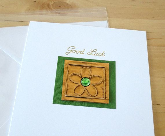This Good luck card is decorated with embossed foil flower, beautiful green rhinestone, green paper & gols Good luck sticker. This good luck card is 15x15 cm (6x6 in) in size and will come with a white envelope in a cellophane bag. To make it special, there is an option to get this card with an organza bag, for a small additional of charge. The inside of this good luck card has been left blank for your own message. All products used are of a high quality and all the work has been done...
