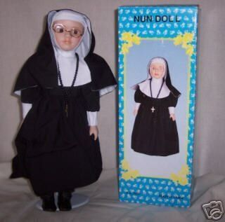 """Nun Doll 16 Porcelain Face Hands & Feet W/stand by Nun Doll. $6.99. NUN DOLL  The Nun Doll will be an inspirational addition to your doll collection. Handpainted porcelain face is frames by traditional habit. Includes removable wire rim glasses, rosary beads, gold tone cross and leather like shoes. About 16"""" tall and comes with its own metal doll stand."""