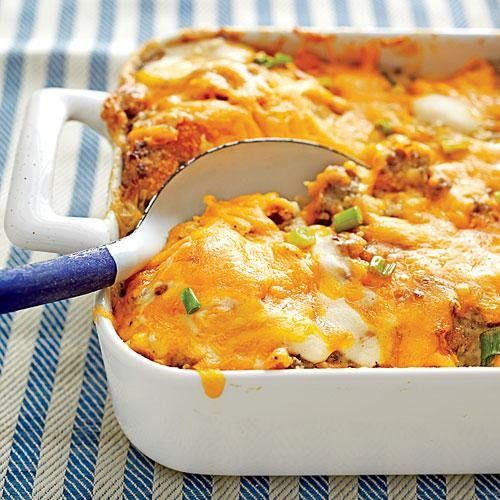 Sausage, Biscuit, and Gravy Bake ~~~ 1 pound ground pork sausage 2 teaspoons canola oil 5 tablespoons butter 1/4 cup all-purpose flour 3 cups milk 3/4 teaspoon salt 1/2 teaspoon pepper Cooking spray 8 refrigerated jumbo biscuits 1/2 cup chopped green onions 3/4 cup shredded sharp Cheddar cheese