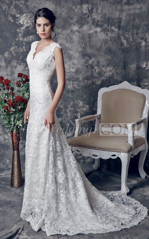 A vintage style long lace wedding dress that comes with a flowing brush train to the back. The floral lace dress has scalloping to all the edges. With a V-shaped neckline to the front and a low V-shape to the back, this sleeveless dress has shoulder straps. Fitting snugly to the curves of the body, with the looser skirt line of a mermaid silhouette. #Doris #Wedding #lace #wedding #dresses #wedding #dress #lace #wedding #dress #styles #affordable #wedding #dresses #unique #wedding #dresses
