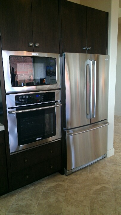 Stove microwave and fridge next to each other Must be