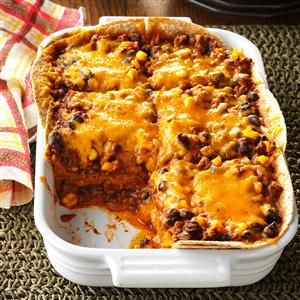 Chili Tortilla Bake Recipe -A homestyle Tex-Mex casserole is all it takes to gather the whole family around the dinner table. With popular flavors and a bubbly cheese topping, you won't have to worry about leftovers. —Celine Weldy, Cave Creek, Arizona