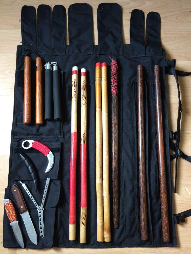 Filipino martial arts wrap around case with my training sticks,knifes,sword,nunchakus and palm stick