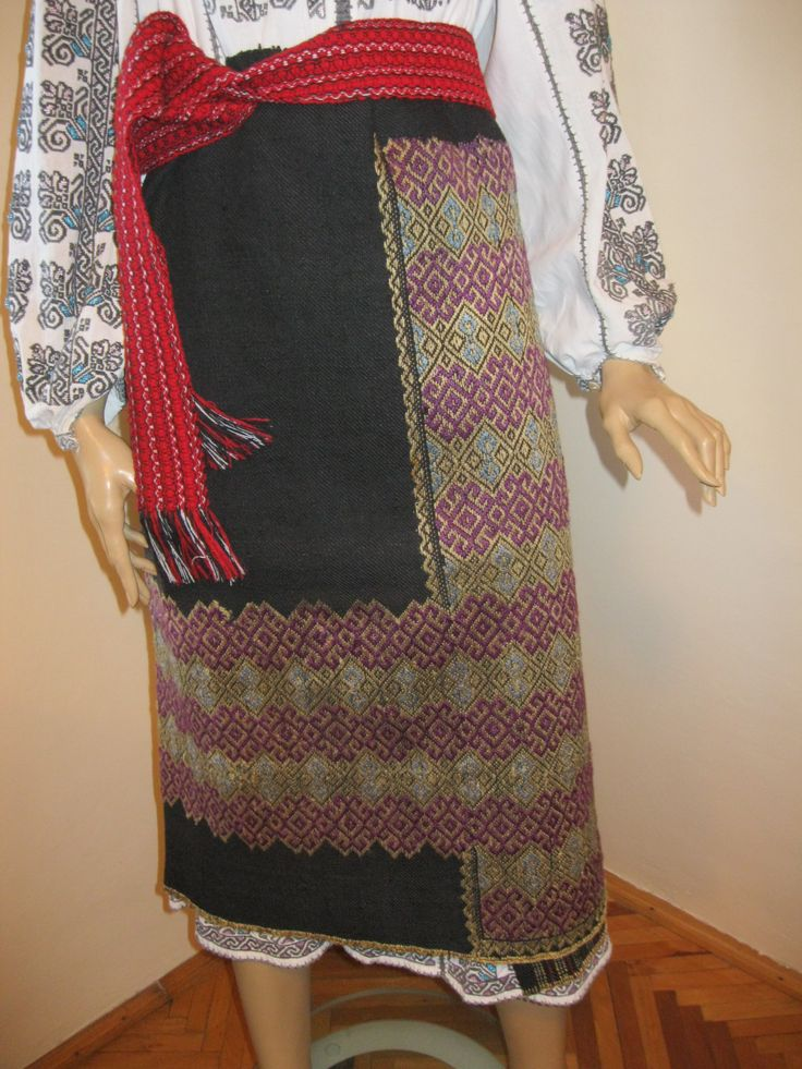 Antique, 80 - 100 years old hand woven Romanian traditional costumes wrap skirt. Hand woven black wool background which was hand embroidered with purple, yellow and gray silk.  For sale at www.greatblouses.com