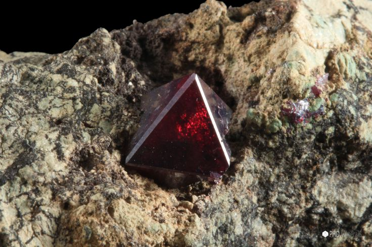 Deep red octagonal crystal of Cuprite (Cu2O) on matrix from the Democratic Republic of Congo. The crystal measures 1 cm. https://phdminerals.com/cuprite