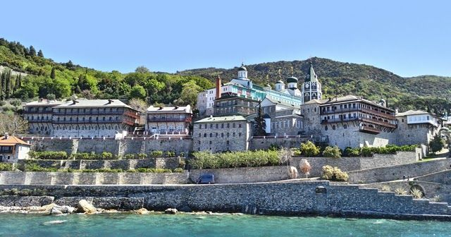 """Ouranoupolis to Mount Athos Chalkidiki: A guide to visiting Agion Oros. Mount Athos is a autonomous polity named """"Autonomous Monastic State of the Holy Mountain"""". Only men are permitted to enter the monasteries. Follow our guide, to find out how to get a permit to visit the Monastic State #greece #chalkidiki #mountathos #monasteries #religion #christianity"""