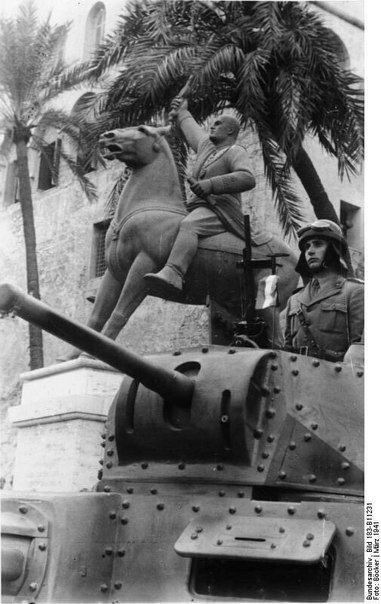 "bmashina: ""  Italian place on the tank in front of a statue of Mussolini. Tripoli, 1941-th year. """