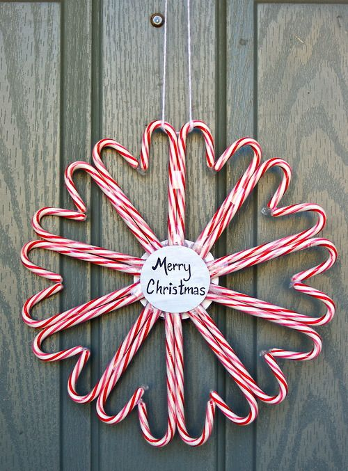 Candy Cane Wreath DIY...I think I would put a snowflake or snowman or something in the middle but this could be cute on an interior door