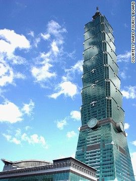 """Fast fact: Taipei 101 was the first building in the world to break through 500 meters. Upon its completion, the tower claimed several records: it had the world's fastest elevator, was the world's tallest building and was the world's tallest structure, thanks to its spire. Eight """"mega-columns"""" make the building especially earthquake resistant. Completion date: December 31, 2004."""