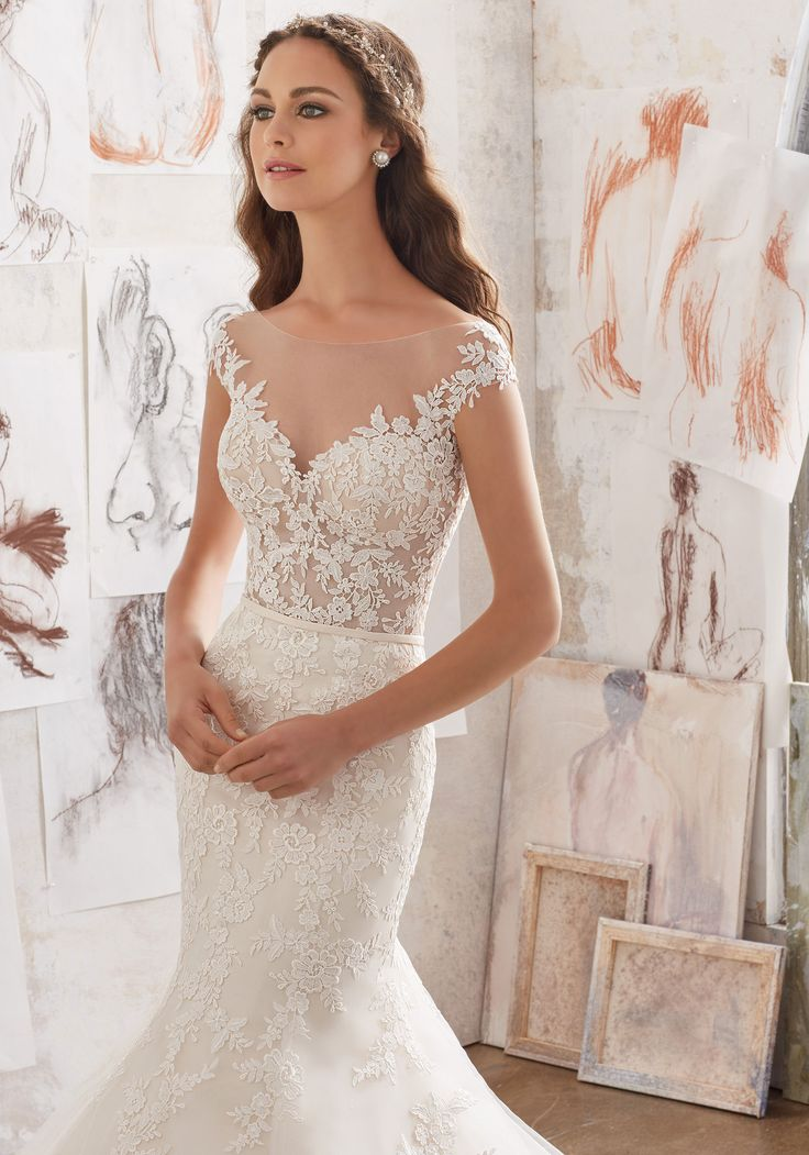 Designer Wedding Dresses and Bridal Gowns by Morilee. Gorgeous Off-the-Shoulder Illusion Wedding Gown with a Embellished Bodice and Lace AppliquéŽs on Net.