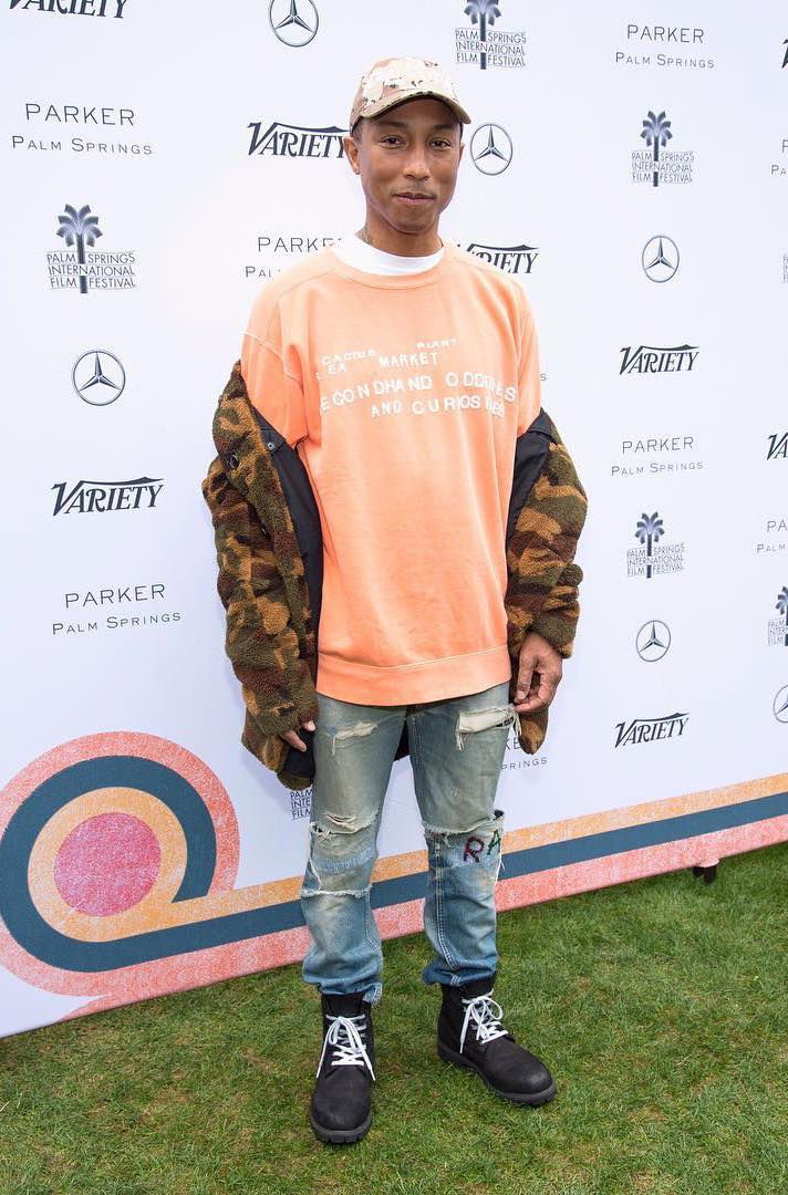 Pharrell Williams Rocks Bedwin & The Heartbreakers Coat, Cactus Plant Flea Market Shirt, G-Star Raw Jeans With Timberland x Supreme Boots