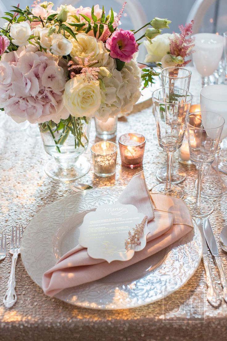Ivory menu cards and dusty rose napkins sat atop pearl-hued charger plates. #placesetting #tablesetting Photography: Christian Oth Studio. Read More: http://www.insideweddings.com/weddings/elaine-alden-and-landry-fields/589/