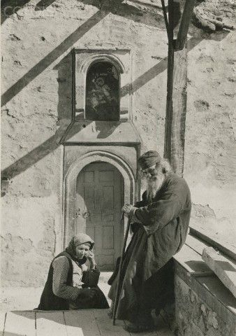 A Greek monk and his wife sit outside of a convent-Fred Boissonnas