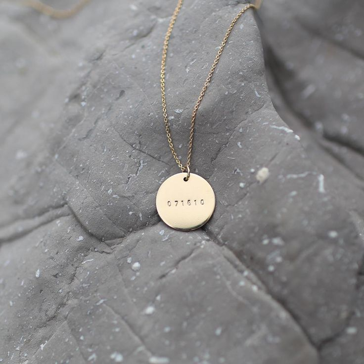 """The day that everything changed. Remember it with this bold 3/4"""" disc pendant. Available in a standard or roman numeral format. Featuring a tiny version of our favorite font. Use this Roman Numeral Da"""