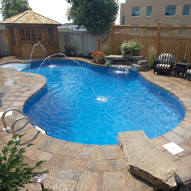 stone decking deck jets waterfall dive rock and pool house perfection