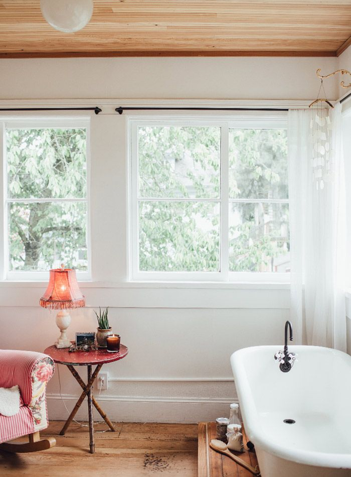 An old sun porch turned master bath and a claw foot tub a pastor s victorian farmhouse in - Design sponge bathrooms ...