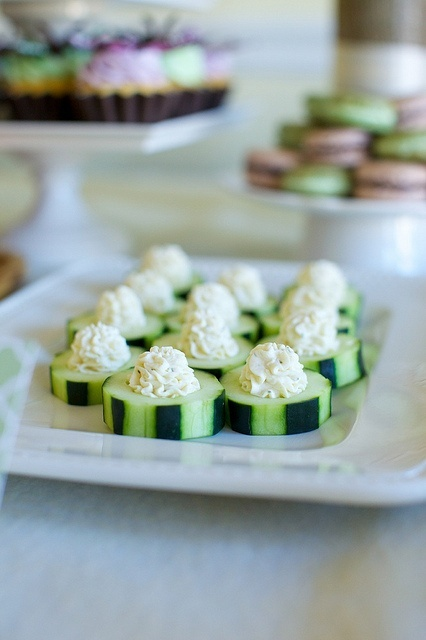 Cucumber slices with piped cheese spread - this simple appetizer is elegant looking and eliminates the mess and potential cross contamination of a communal dip. Use a large star frosting tip (a Wilton #18 would work well) and a sturdy cream cheese based dip that won't collapse at room temperature.