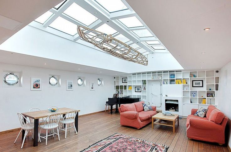 Stunning Barge Conversion in Stockholm - we love all of the natural light on this barge... It's great that they left the portholes intact to retain the charm.