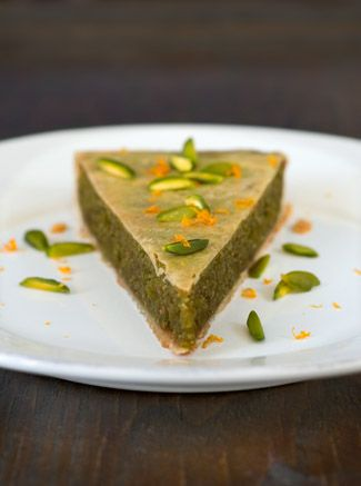 Pistachio and almond tart with orange and cardamom.  i love pistachios ...and almonds..and orange...and cardamom...and tarts.   this looks delicious!