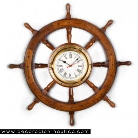 TIMON RELOJ Timón de barco decorativo con reloj. Rueda de timón con ocho brazos realizada en madera de palisandro con un reloj central en latón con 3 manecillas.   Medidas: Alto:47.00 x Largo:47.00 x Ancho:8.00 cm