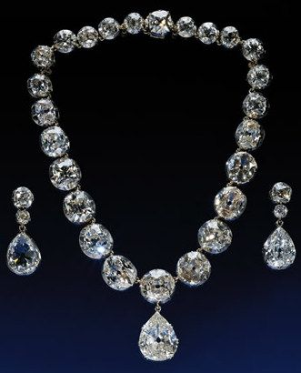 """Queen Victoria's famous diamond necklace and tear dropped earrings have an interesting history. Victoria had to hand over to the Duke of Cumberland, king of Hanover in 1857 a chunk of her inherited jewelry. This angered and upset her immensely. She ordered the royal jewelers to make carbon copies of the lost jewelry. This exercise was carried out by using precious stones from """"swords and useless things"""", as put by her. This necklace needed 28 stones taken from 2 Garter badges and a sword…"""