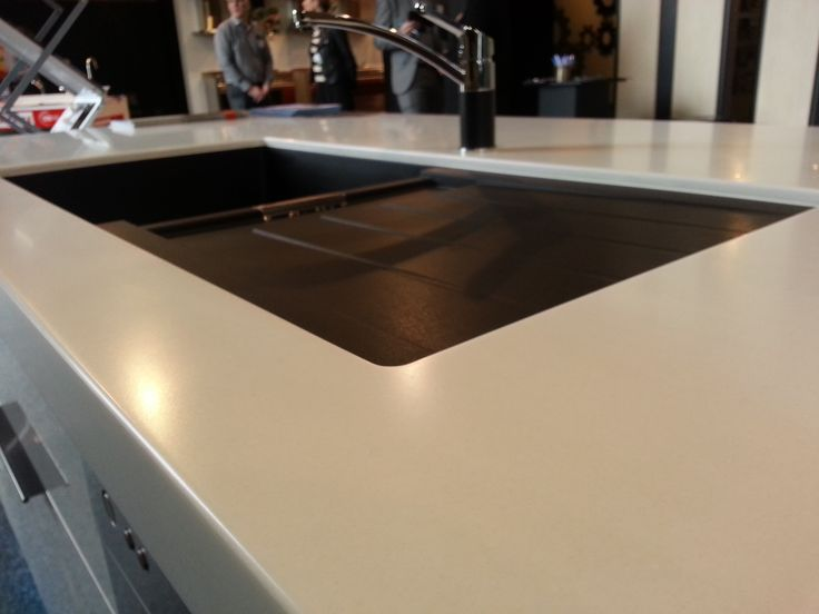 Close up of a Laminex Solid Surface Stratus bench top My Dream Kitchen Designed and manufactured by Di Rosa Cabinetry & Furniture, table and bench top fabricated by Pacific Stone