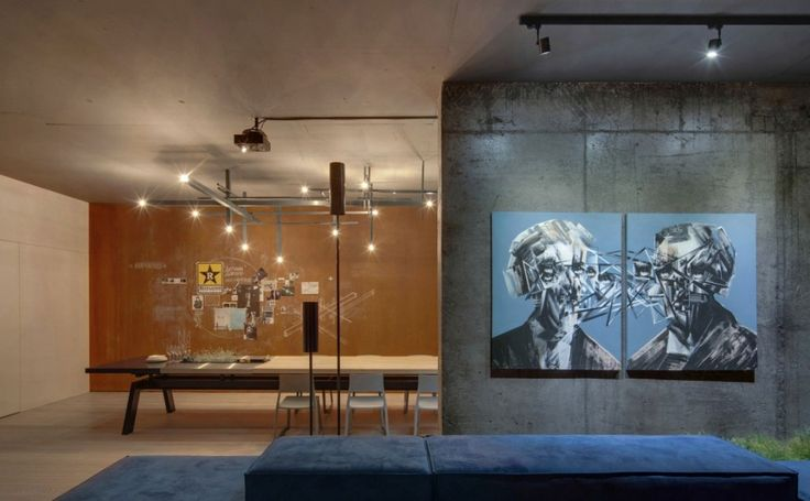 Loft: Cool Urban Loft in Kiev, Ukraine Designed by 2B Group, Cool Night View of Urban Loft Living Room and Dining Area with Exposed Wall and Industrial Ceiling Lights and Epic Wall Painting Decor also Huge Dining Table and Retro Wall Decorations