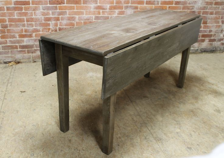 Drop leaf tables built to order from reclaimed wood in