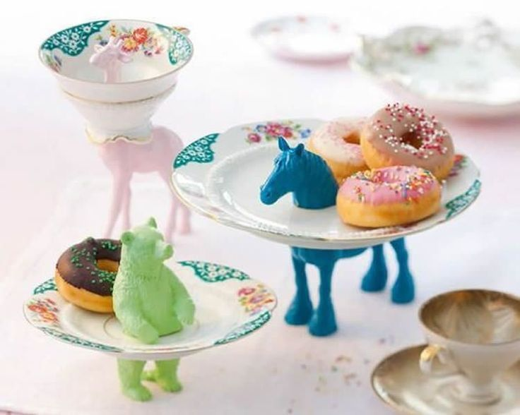 plastic animals and tea cup and plates - what a cute idea