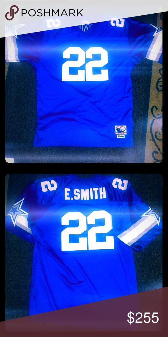 🏈Emmitt Smith 1990 Authentic Dallas Jersey🏈 A shift in ownership power prior to the 1989 season called for a new era in Dallas. The Cowboys fired their lovable fedora clad head coach, the only man to be the head coach up until that point, and began piecing together a championship caliber team. By the 1992 season the Dallas Cowboys established themselves as the most revered team in the NFL. They barreled their way through the NFC with the combined fire power of Troy Aikman, Emmitt Smith…