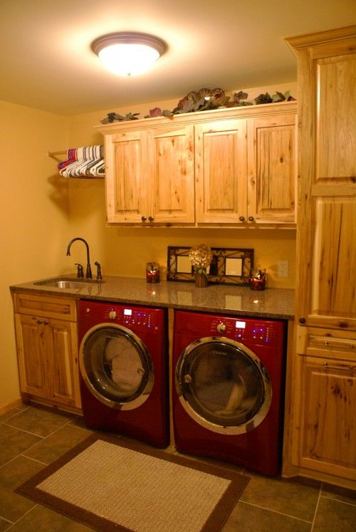 Front load washer/dryers with a counter across the top.