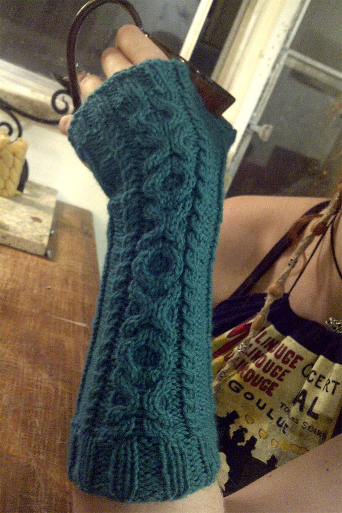 Free Knitting Pattern for Love Me Forever Mitts - Fingerless wristwarmer with a XOXO hugs and kisses cable design. Worsted weight yarn. Designed by Gecika Knits