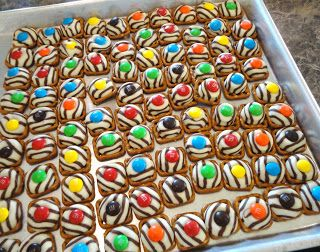 Put a kiss on a pretzel and bake 5 min at 200 then add m's. Making these with Christmas colors! Great idea!