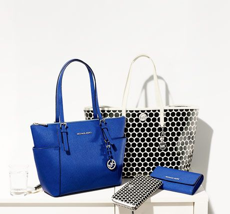 Michael by Michael Kors handbags and wallets in new fall colors and prints.