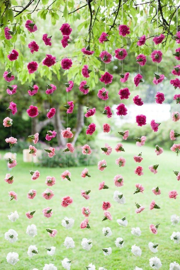 Blurry selfies have got nothing on photos backdropped with carnations. | 26 Ideas For Throwing The Boozy Tea Party Of Your Wildest Dreams