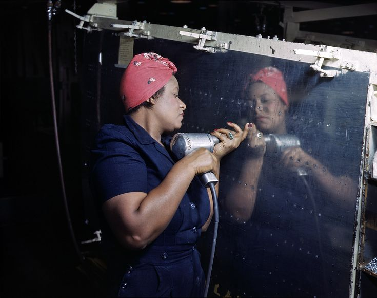 "African American woman working  on a ""Vengeance"" dive-bomber at Vultee-Nashville. February 1943"