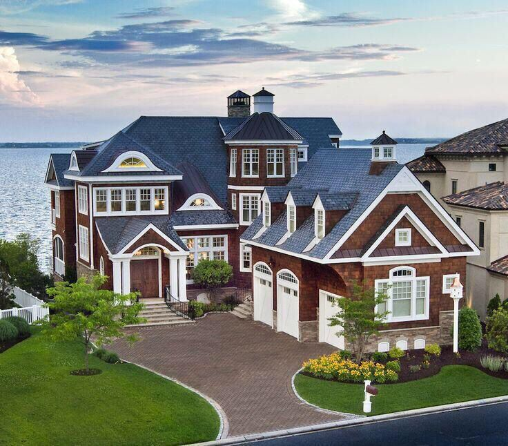 Gorgeous lakefront home! Love the detail on the exterior