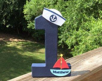 Decoración de número de cumpleaños de temática náutica Más