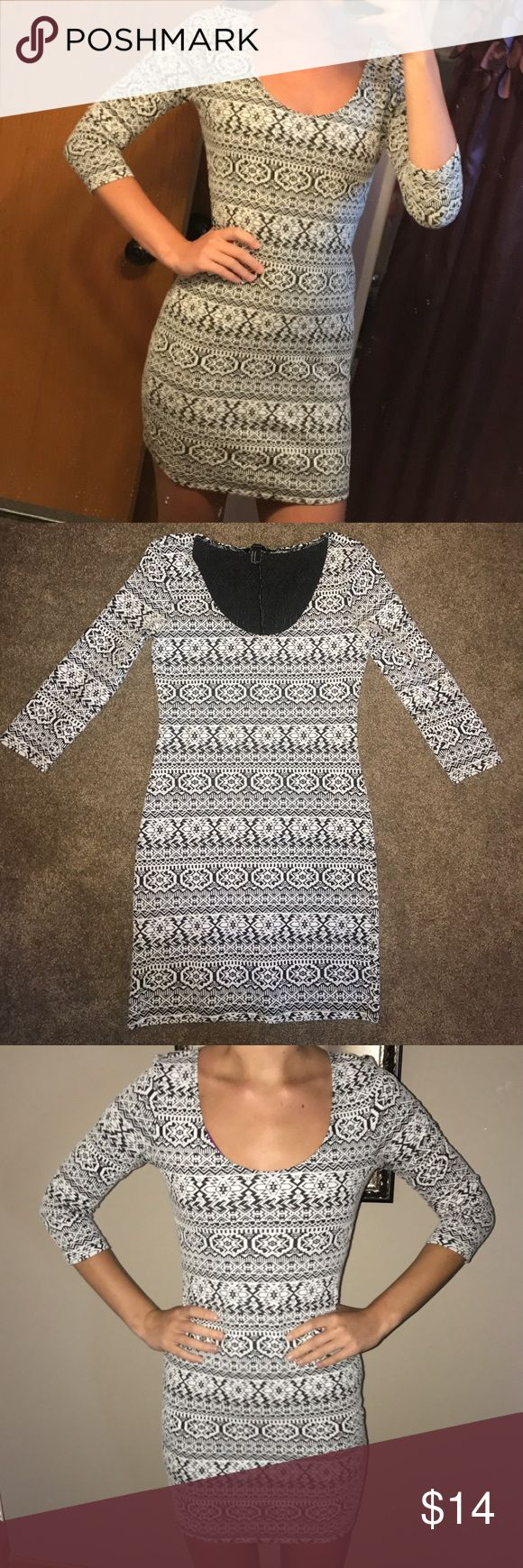 Forever 21 Aztec tight fitting dress 3/4 length sleeves. Stretchy material. Worn only once, in great condition. 54% polyester, 43% cotton, 3% spandex. Forever 21 Dresses Mini