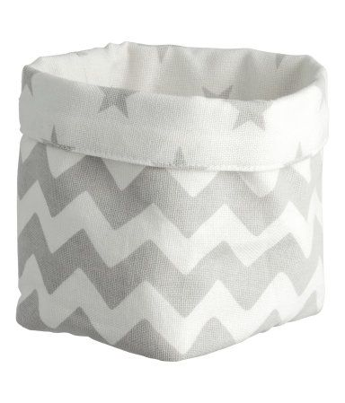 Light gray/patterned. Small storage basket in cotton canvas with a printed pattern. Size 3 x 3 1/2 x 3 3/4 in.