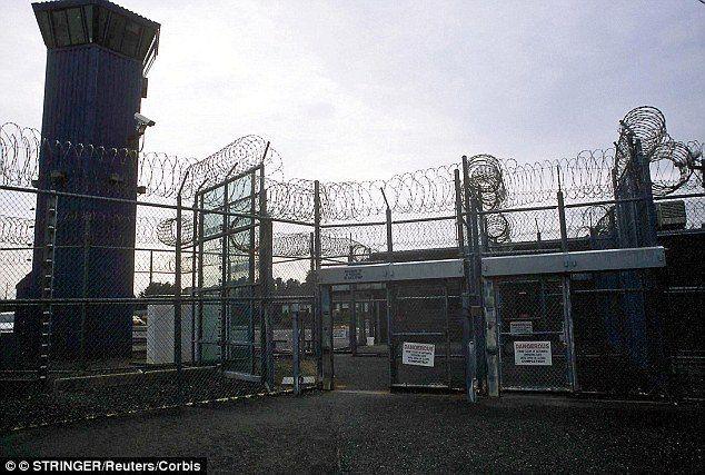 Pelican Bay SP fences, gates, razor wire, guard tower by Reuters-Corbis