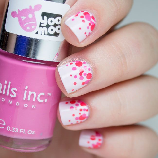 Polka dot nails with different shades of pink & white base.