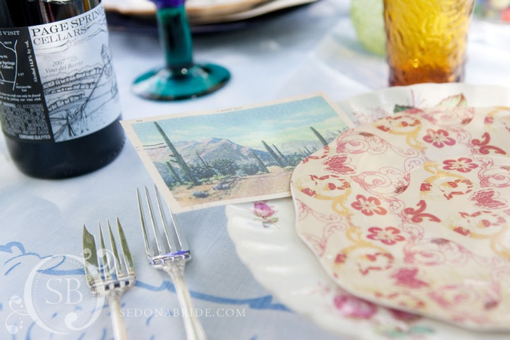 mismatched china and old post cards... so pretty! photography by sedona bride www.sedonabrideblog.com  designed by www.vandammeweddings.com