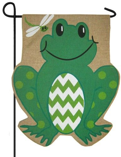 Frog shaped garden flag featuring a sculpted burlap background with a friendly, smiling frog sporting green and white chevrons. The friendly little dragonfly in the top left corner adds the final fun