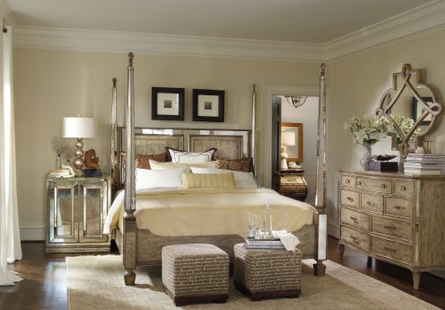 Elegant Bedroom with rustic touches. Mirrored bed and nightstands offset the natural wood dresser.