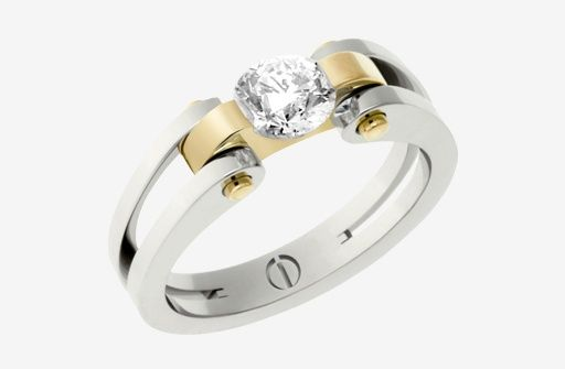 Platinum and gold are tensioned to hold this 0.45 carat brilliant cut diamond. An original design from The Inspired Collection.