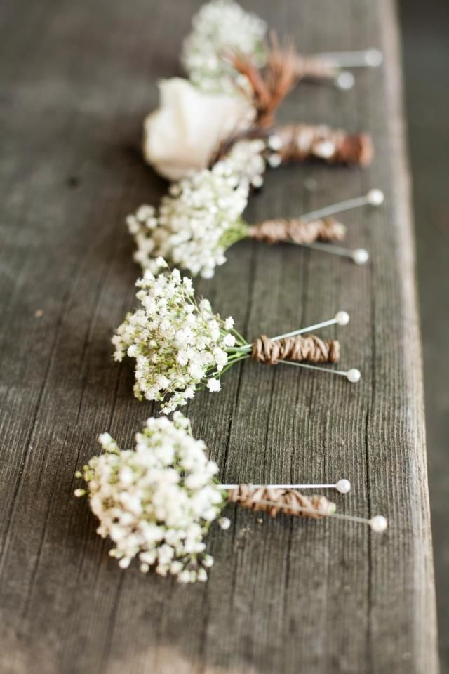 love the babybreath boutonnieres for the groomsmen