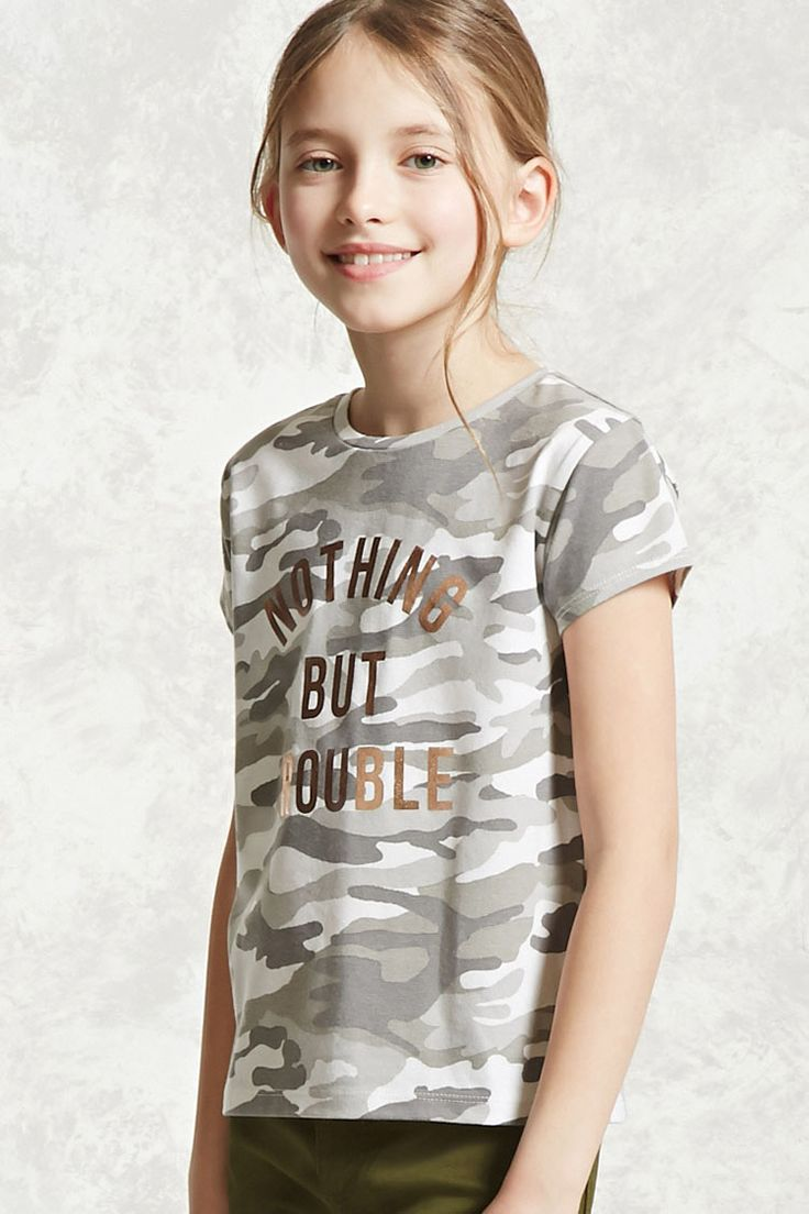 """Forever 21 Girls - A knit tee featuring a metallic """"Nothing But Trouble"""" graphic on the front, an allover camo print, round neckline, and short sleeves."""